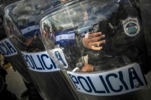 Tropas de choque durante una protesta contra el sistema electoral en Managua, Nicaragua, el 15 de julio de 2015 (AFP/Archivos | Inti Ocon)